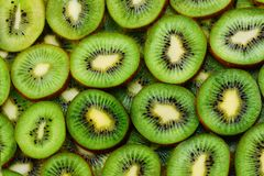 view of heap of sliced kiwi as textured background stock images