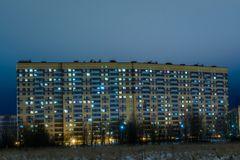 The new building in the night in the suburb of the big city. The view from the heath Royalty Free Stock Image