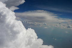 A View from Heaven -2. View of cumulus clouds, sky and ground from a plane Stock Photos