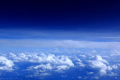 A view from heaven. A view from above white clouds, with the blue sky in the back ground Royalty Free Stock Photo