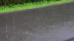 View of heavy rain on road stock footage