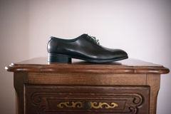 View of the heel and shiny leather of a black pair of male shoes Royalty Free Stock Image