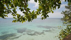 View from the height of the balcony to the ocean and coral reefs of the shallow waters of the Philippine tropics. Exotic stock footage