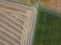View from the height of a bird`s flight from flying drones to agricultural fields, prepared for sowing crops. stock photos
