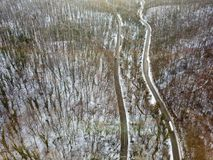 View from height on car driving through winter forest road. wint. View from height on car driving through winter forest road. Scenic winter landscape Stock Photography