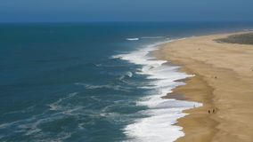 View from the height on a deserted beach. The Portuguese coast of the Atlantic Ocean. Aerial drone footage of ocean waves reaching shore stock video footage