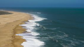 View from the height on a deserted beach. The Portuguese coast of the Atlantic Ocean. Aerial drone footage of ocean waves reaching shore stock video