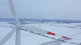 View from the height of energy producing wind turbines in winter, Poland. Filmed at various speeds: normal and. Aerial view of energy producing wind turbines in stock video