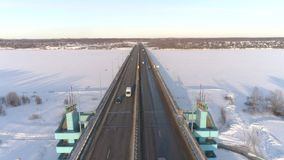 View from the height of the jubilee bridge in Yaroslavl and the traffic junction. Russia, winter. 4K stock footage
