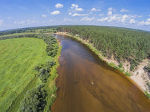 The view from the height of the river Mologa and forest. Aerial view. The view from the height of the river Mologa and forest along the sandy shore. Venue Stock Images