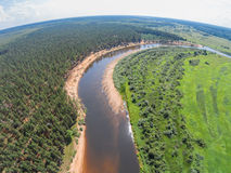 The view from the height of the river Mologa and forest along the sandy shore. Shooting from height of the bird`s flight. Maksatikhinsky District, Tver Region Royalty Free Stock Images