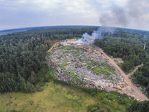 The view from the height of smoke fire on garbage dump. Aerial view. The fire on the official Municipal Solid Waste Landfill in Maksatikha Stock Photo
