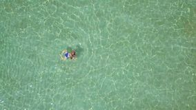 View from the height on swimming woman in the clear sea stock video footage