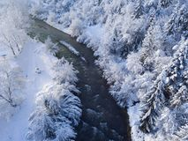 View from a height to a winter landscape - a mountain river surr Royalty Free Stock Photo