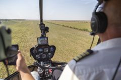 View from helicopter cockpit Robinson R44. During flying Stock Image