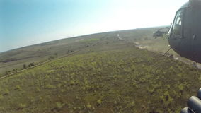 View from Helicopter Flying at battlefield POV stock footage
