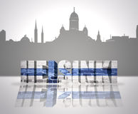 View of Helsinki. Word Helsinki with national flag of Finland near skyline silhouette Royalty Free Stock Images