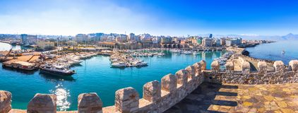 View of Heraklion harbour from the old venetian fort Koule, Crete, Greece. Panorama Heraklion harbour with old venetian fort Koule and shipyards, Crete, Greece Stock Photo