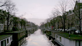 View of heritage city canals (Jacob van Lennepkanaal) of Amsterdam stock footage