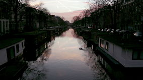 View of heritage city canals (Jacob van Lennepkanaal) of Amsterdam stock video