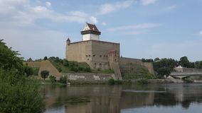 View of Herman Castle in the August afternoon. Narva, Estonia. View of Herman Castle in the August afternoon. Narva. Estonia stock footage