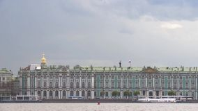 View of the Hermitage in Saint-Petersburg from Neva River in cloud summer day stock footage