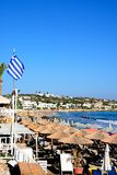 View of Hersonissos beach, Crete. Tourists relaxing on the beach with views along the coastline, Hersonissos, Crete, Greece, Europe Stock Photography