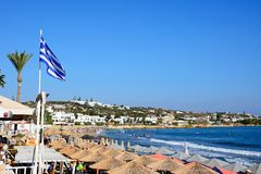 View of Hersonissos beach, Crete. Tourists relaxing on the beach with views along the coastline, Hersonissos, Crete, Greece, Europe Royalty Free Stock Photo