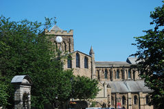 View of Hexham cathedral from main street in summer. Cathedral and architecture in Hexham from main street in summer Stock Images