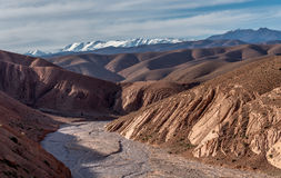 View of High Atlas mountains with dry river bed Stock Photo
