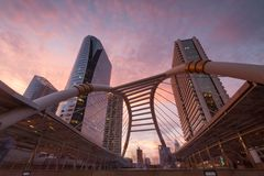 View of high buildings and public sky walk for transit between Sky Transit and Bus Rapid Transit Systems at Sathorn-Narathiwas stock image