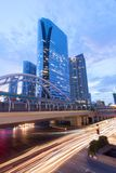 View of high buildings and public sky walk for transit between Sky Transit and Bus Rapid Transit Systems at Sathorn-Narathiwas royalty free stock photography