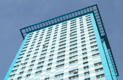 View of high modern apartment building on blue sky Royalty Free Stock Photos