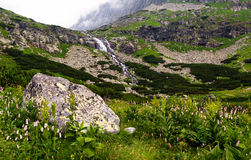 View of the high mountains with a waterfall. Royalty Free Stock Images