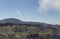 View of high plateau village, forest and mountain royalty free stock photography