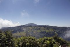 View of high plateau village, forest and mountain royalty free stock photos