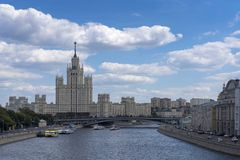 View of the high-rise building in Moscow and the bridge from the river stock photography