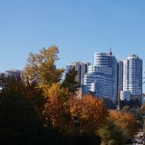 View of high-rise buildings on the mountain. Autumn landscape. stock photo