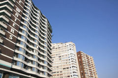View of High Rise Hotel and Apartments Against Blue Sky Royalty Free Stock Image