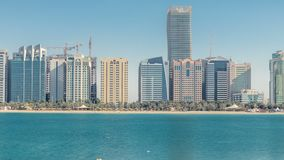 View of high skyscrapers on a corniche in Abu Dhabi stretching alongside the business center timelapse. View of a corniche in Abu Dhabi stretching alongside the stock video