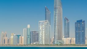 View of high skyscrapers on a corniche in Abu Dhabi stretching alongside the business center timelapse hyperlapse. View of a corniche in Abu Dhabi stretching stock video