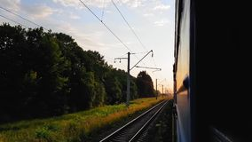 The view from the high-speed train on the beautiful scenery with hills and forest before sunset. The view from the. The view from the high-speed train on the stock footage