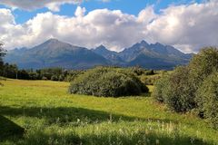 View of the High Tatras in Slovakia. With green field Royalty Free Stock Photography