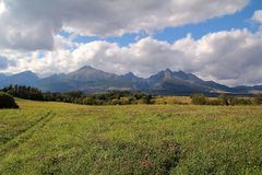 View of the High Tatras in Slovakia. With green field Stock Photos