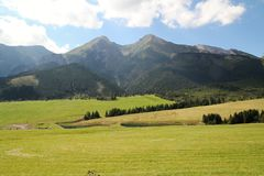 View of the High Tatras in Slovakia. With green field stock photography
