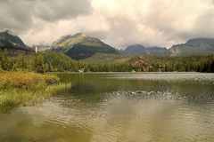 View of the High Tatras-Štrbské Pleso village National park in Slovakia. Štrbské pleso lake in the foreground stock photo