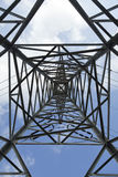 Pylon Abstract. View at a high-voltage electricity pylon from directly below, which deconstructs the subject from its function and treats it as a mere Royalty Free Stock Image