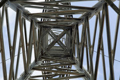 Pylon Abstract. View at a high-voltage electricity pylon from directly below, which deconstructs the subject from its function and treats it as a mere Stock Photos