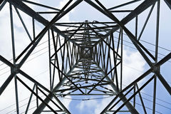Pylon Abstract. View at a high-voltage electricity pylon from directly below, which deconstructs the subject from its function and treats it as a mere Royalty Free Stock Images