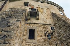 View of high wall with window and embrasure in ancient Olesko castle. Lviv region in Ukraine. Cloudy summer day.  stock photos